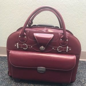 Beautiful red leather bag with rolling ability